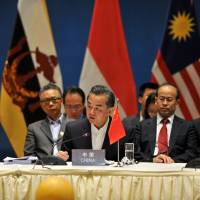 Chinese Foreign Minister Wang Yi (front) and foreign ministers from ASEAN members attend a special ASEAN-China meeting on Tuesday in Yuxi, China. | AFP-JIJI