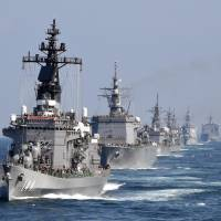 The Maritime Self-Defense Force escort ship Kurama leads during a fleet review off Kanagawa prefecture's Sagami Bay on Oct. 18. Much of the current military spending across Asia is driven by China's assertiveness in the East and South China seas. | AFP-JIJI