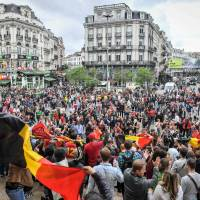 Belgium charges three men with terrorism offenses over Euro 2016 games