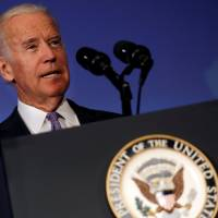 Candidate's 'sound bite solutions' will imperil democracy, U.S., Biden says without naming names