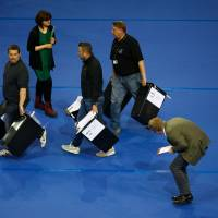 Ballot boxes are brought into the Glasgow count center at the Emirates Arena, Glasgow, Scotland, on Thursday after polls closed in the referendum on whether the U.K. will remain or stay in the European Union (EU). | AFP-JIJI
