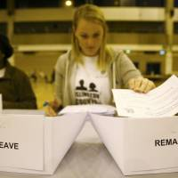 A worker counts ballots after polling stations closed in the Referendum on the European Union in Islington, London, Thursday. | REUTERS