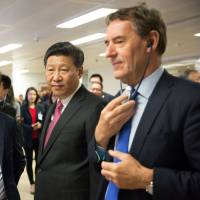Chinese President Xi Jinping (second right), is shown around the London offices of Huawei Technologies Co. Ltd. by Ren Zhengfei (second left), billionaire and president of the company, in October 2015. | BLOOMBERG