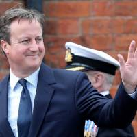 British Prime Minister David Cameron smiles during Armed Forces Day at Cleethorpes, England, on Saturday. | AP