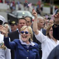 Democratic presidential candidate Hillary Clinton waves as she walks in a Memotial Day parade Monday in Chappaqua, New York.   AP