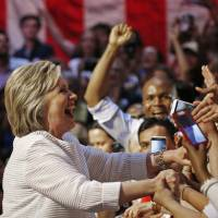 Clinton seizes historic role as female presidential nominee as Trump campaign hits new low