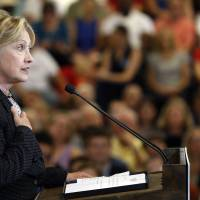 'Reckless' Trump would spark U.S. recession, tank global economy: Clinton