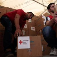 First aid convoy enters Syria's besieged Daraya since 2012: Red Cross