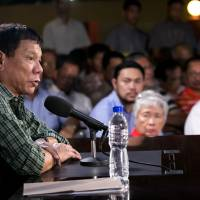Duterte says South China Sea policy to be independent of U.S., supports killing corrupt journalists
