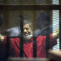 Egypt's former Islamist president sentenced to life in espionage trial