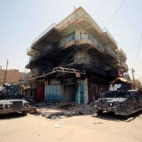 Homes burned, looted in Iraqi city as Islamic State driven out