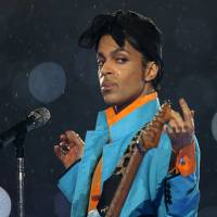 Prince performs during the halftime show of Super Bowl XLI in Miami in February 2007. | REUTERS