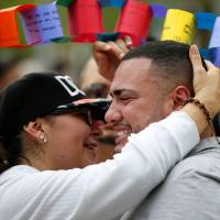 Long victimized, including by Islamic State killers, global gay ranks mourn Orlando dead, stand united