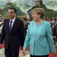 Merkel pushes rule of law, NGO access in China