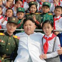 North Korean leader Kim Jong Un marks 70 years of the Korean Children's Union in this photo released June 8.   REUTERS