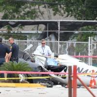 Three killed as small plane crashes into parked car near Houston airport