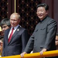 Putin heads to China to cement ties, but obstacles remain