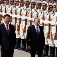 Russian President Putin meets with Chinese leaders