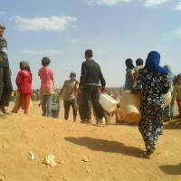 Stranded Syrian refugees' desert plight worsens as Jordan blocks aid