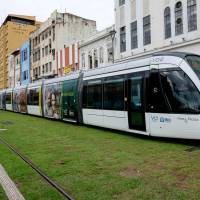Rio rolls out new light rail ahead of Olympics as protesters hit costs, WHO weighs Games delay over Zika