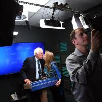 Sanders tells followers he will work with Clinton to change party, push wage hike, defeat Trump