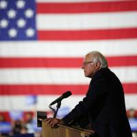 Sanders returns to Washington, meets with Obama on next steps