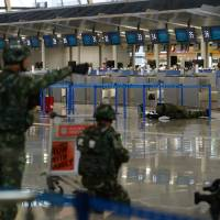 Four hurt as blast rocks check-in area at Shanghai's main international airport