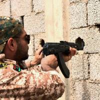 Libyan forces enter Islamic State's Sirte bastion, seize bridge used as gallows