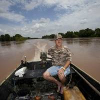 Residents flee as Texas river reaches record-high crest, reservoirs spill over