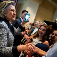 Clinton edge over Trump eases after Florida massacre but more also favor neither: poll