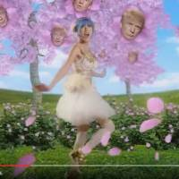 A young woman made to look like a Donald Trump-obsessed Japanese girl frolics among cherry blossom trees bearing the U.S. presidential candidate's likeness in this screen shot taken from the YouTube video 'Japanese Donald Trump Commercial.'