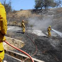 Canyon wildfire veers away from ritzy California enclave