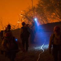 'Sundowner' winds loom as crews try to contain home-threatening Western wildfires