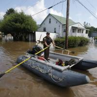 West Virginia keeps eye to sky as it starts to recover from record floods, revises death toll down to 23