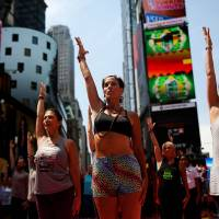Yogis throng Times Square to fete solstice