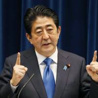 Abe delays tax hike weeks before election