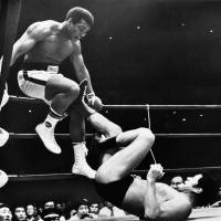 Inoki sits on his fortune as Ali dances to the bank