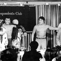 Muhammad Ali and Antonio Inoki pose during a news conference at the Foreign Correspondents' Club of Japan in Tokyo ahead of their 1976 fight at Nippon Budokan Hall.   KYODO