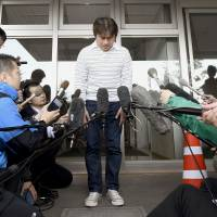 Takayuki Tanooka meets with reporters Friday in Hakodate after his 7-year-old son, Yamato, was found safe after being left on a mountain road last Saturday as punishment for misbehaving. The 44-year-old father apologized for the trouble he caused. | KYODO