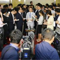 Finance Minister Taro Aso faces reporters in Tokyo on Friday as Britain's vote triggered turmoil in financial markets. | KYODO