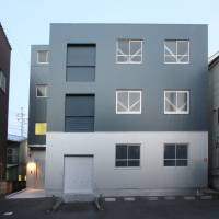 An 'itai hoteru,' or corpse hotel, stands in a residential and industrial area of Kawasaki. It is registered as a storage facility, but it allows mourners to stay the night. | COURTESY OF SOU SOU
