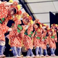 Fukushima child evacuees find hope in traditional folk dancing