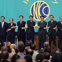 Leaders of political parties join hands before a policy debate at the Japan National Press Club in Tokyo on Tuesday, the day before the official start of campaigning for the July 10 Upper House election.   SATOKO KAWASAKI