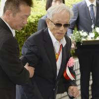 Yasushi Shimura, a former leprosy patient, attends a memorial ceremony at the health ministry in Tokyo on Thursday. | KYODO