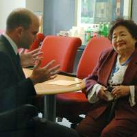 Hiroshima survivor meets Obama aide, urges end to nuclear weapons