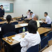 Teachers attend a study meeting to discuss LGBT issues in Tokyo on May 14. | KYODO