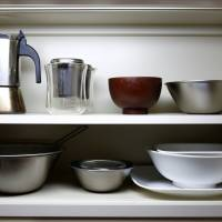 A kitchen cupboard in the Tokyo apartment of minimalist Fumio Sasaki has only the bare essentials. | REUTERS
