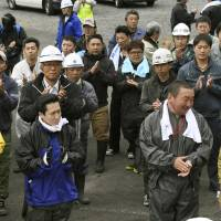Rescuers celebrate after they hear the news that Yamato Tanooka, 7,  who had been missing since last Saturday, was found alive Friday in Nanae, Hokkaido. | KYODO