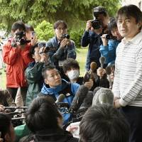 Takayuki Tanooka, father of 7-year-old Yamato who was found after missing for six days, speaks to reporters Friday at a hospital in Hakodate, Hokkaido, where his son was sent. | KYODO