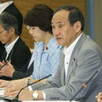Chief Cabinet Secretary Yoshihide Suga speaks during a meeting at the Prime Minister's Office on Friday. | KYODO
